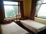 Bedroom has a view of the Kanchenjunga range weather permitting.