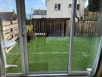 Newly astro turfed fully enclosed dog friendly garden view from ground floor ensuite bedroom