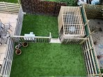 Newly astro turfed fully enclosed dog friendly garden view from top floor balcony