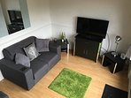 Spacious Lounge with Patio doors - Large TV - Sprung based Sofa Bed & 2 seater