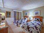 Guest bedroom with twin beds and en suite bath.