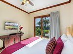 Master Bedroom with king bed, flat screen TV and garden views