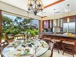 Kitchen dining area opens up to lanai and koi gardens