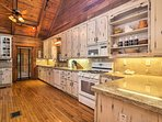 Shabby-chic cabinetry lines the large fully equipped kitchen.