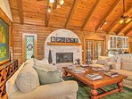 Lovely vigas support the pine-paneled vaulted ceilings in this main living space.