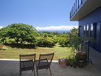Giant covered lanai overlooking the cacao orchard and ocean for your relaxing pleasure.