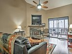 Warm up by the electric fireplace and enjoy a movie on the  flat-screen cable TV.