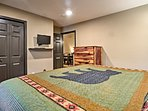 The second bedroom is equipped with a king bed and flat-screen cable TV.
