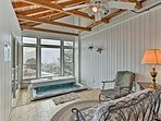 This home sleeps 9 and boasts mountain views from the indoor hot tub.
