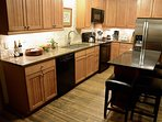 Updated Kitchen with new granite counters, backsplash, and appliances