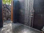 Private outdoor shower off downstairs bedroom.