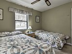 With a twin bed and full bed, this room sleeps 3.