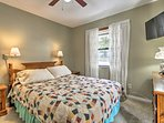 The master bedroom houses a cozy queen-sized bed.