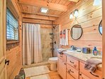 Take a refreshing shower in this large bathroom.