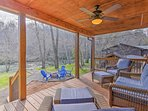 Enjoy river views from the porch of this vacation rental cabin in Murphy!