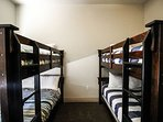 This unit features a double-double bunk bed room, perfect for ki