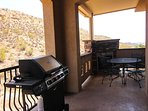 Private patio features a personal BBQ, gas fireplace, and dining