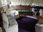 The living room at Ballyogan Doors - wood-burning fire, lots of pillows and warm throws welcome you.