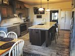 NEW country kitchen with granite counters. Ideal for gathering and preparing large family meals.