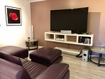 65' Smart TV and surround sound Movie room with en-suite