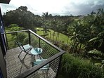 Hilo Bay Room private lanai overlooking lush tropical landscape and Hilo Bay