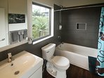 Full ensuite bathroom with tub.