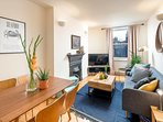 The inviting living area is open-plan - kick back on the sofa and relax...