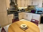 family dining and compact yet well stocked kitchen