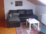 A living area with a sofa.