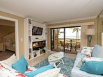 New 2018 upscale living room furniture and cozy fireplace.  Watch dolphins play from the lanai