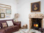 Plenty of comfortable seating and a cosy wood burning stove