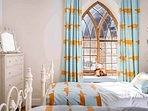 A bright and stylish twin room