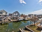 Waterfront getaway in quiet neighborhood w/ free WiFi, dock, & furnished deck