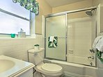 Enjoy a freshwater rinse in this full bathroom with a shower/tub combo with sliding glass doors.