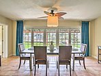 Choose to dine inside at this lovely table with seating for 6 and beautiful backyard views.