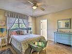 Two guests can claim this second queen bedroom beautifully furnished with pastel accents.