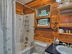 Take a relaxing soak in the shower/tub combo.