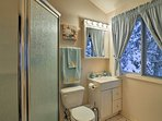 This bathroom boasts a large walk-in shower.