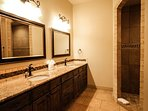 Master bath features a double sink, jetted tub, spacious shower,
