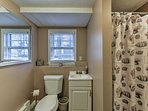 Prepare for a day in Boston in this large bathroom.
