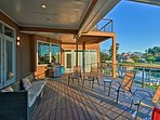 This exclusive home boasts a 3-level deck space with outdoor furnishings.