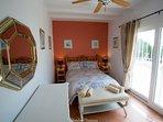 Main bedroom with patio doors to terrace