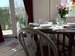Separate dining room with french windows opening to the private garden