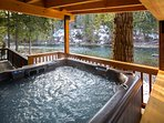 6 person hot tub overlooking the river.