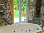 Full bath and shower overlooking garden