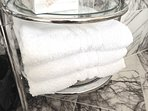 Plenty of fresh clean towels, of various sizes including extra large bath size
