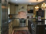 Executive stainless steel Bosch kitchen appliances including a dual temperature control wine fridge