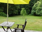 Uninterrupted view from rear timber decking across sweeping lawns