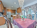 Enjoy your formal meals at the 4-person dining table.