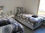 Chambre 3 avec deux lits simples très confortables_01